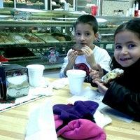 Photo taken at Donut Scene by Mandi S. on 12/18/2013