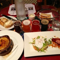 Photo taken at Left Bank Brasserie by Michael P. on 6/24/2013