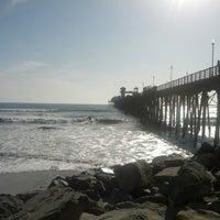 Photo taken at Oceanside Pier by Annya E. on 3/21/2013