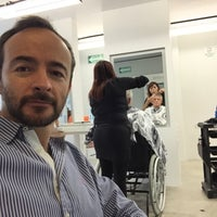 Photo taken at K&L salon by Fernando V. on 8/11/2016