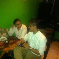 Photo taken at Cocos Sport Bar by Bismarck O. on 6/21/2013