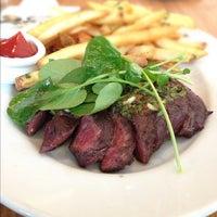 Photo taken at Ella Dining Room & Bar by Burger J. on 12/6/2012