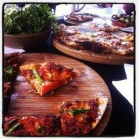 Photo taken at Est Pizzeria by Mandi W. on 1/14/2013