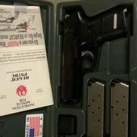 Photo taken at Evans Gunsmithing Shooters World by John M. on 10/7/2012
