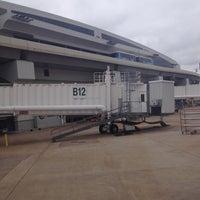Photo taken at Gate B12 by Rodania on 4/4/2013