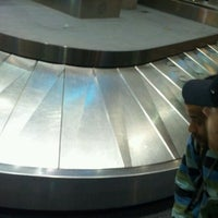 Photo taken at Baggage Claim by Ryan P. on 12/29/2011