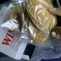 Photo taken at Wina Modern Bakery by willy g. on 11/22/2011