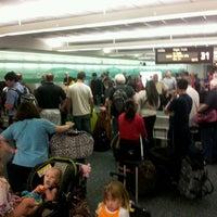 Photo taken at Orlando International Baggage Claim by Brian K. on 3/16/2012