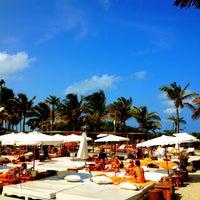 Photo taken at Nikki Beach Miami by Louis P. on 5/13/2012