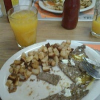 Photo taken at Latin American Restaurant& Cafeteria by Tatiana C. on 4/23/2012