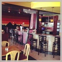 Photo taken at Artisan Coffee Bistro by Brad T. on 8/2/2013