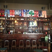 Photo taken at Tigín Irish Pub and Restaurant by Aaron B. on 7/19/2013