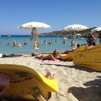 Photo taken at Konnos Beach by Theodoros H. on 7/26/2013
