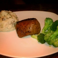 Photo taken at Outback Steakhouse by Lena S. on 12/9/2012