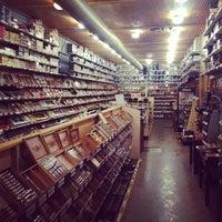 Photo taken at Jenuwine Cigar Lounge by Ruben G. on 3/13/2014