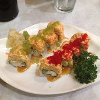 Photo taken at Amura Japanese Restaurant by Camile T. on 7/23/2013