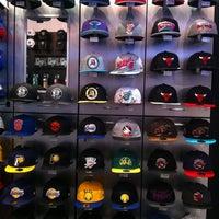 Photo taken at New Era Flagship Store: Toronto by Julie B. on 9/30/2012