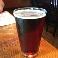 Photo taken at The Lodge Beer and Growler Bar by Matt A. on 4/15/2013