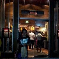 Photo taken at Nando's by Maz E. on 8/10/2012