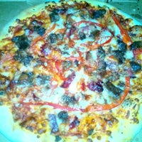 Photo taken at Domino's Pizza by Burcu E. on 10/5/2013
