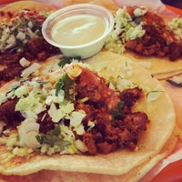 Photo taken at Tacos La Lomita by Tiffany on 11/5/2013