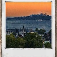 Photo taken at Conrad Teras Restaurant by Bülent Ç. on 7/17/2014