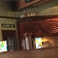 Photo taken at The Lion & Rose British Restaurant & Pub by Starr M. on 3/29/2014