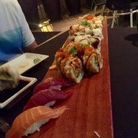 Photo taken at Okura Robata Sushi Bar and Grill by Kevin J. on 6/18/2016