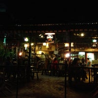 Photo taken at Seaslug's Beach Bar And Resto by RVHalili on 10/3/2012