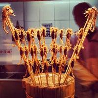 Photo taken at 王府井小吃街 Wangfujing Food Alley by Gaganjot K. on 3/12/2013