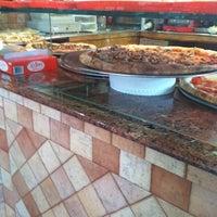 Photo taken at La Strada Pizzeria & Restaurant by Lauren T. on 2/2/2013