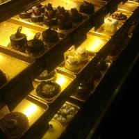 Photo taken at Truffles & Tortes Dessert Cafe by Alisa K. on 2/14/2013