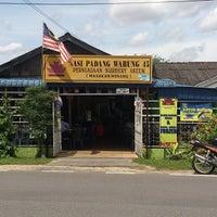 Photo taken at Nasi Padang Warung 45 by Gloria L. on 11/21/2013