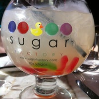Photo taken at Sugar Factory by Katie B. on 5/27/2013