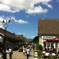 Photo taken at Bicester Village by Oil T. on 6/3/2013