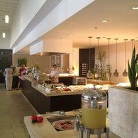 Photo taken at El Palmar Restaurant by Manuel B. on 3/21/2013