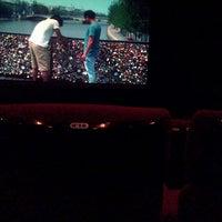 Photo taken at Cinema 21 by Rizky P. on 12/20/2013