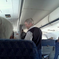 Photo taken at Gate A29 by Rebecca D. on 5/18/2012