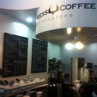Photo taken at Press Coffee Roasters by Chris T. on 4/18/2012