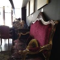 Photo taken at Linger Cafe & Lounge by Nate F. on 4/6/2012