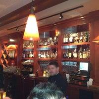 Photo taken at Fleming's Prime Steakhouse & Wine Bar by Aj V. on 3/12/2012