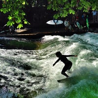 Photo taken at Eisbach Wave by Sergey I. on 8/24/2013