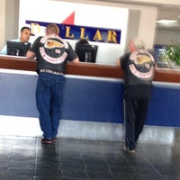 Photo taken at Dollar Rent A Car by Mike C. on 3/15/2013