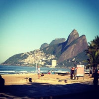 Photo taken at Praia de Ipanema by Daniel H. on 5/12/2013