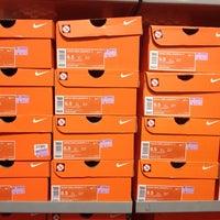 Photo taken at Nike Factory Store by Kuan Yin L. on 1/18/2014