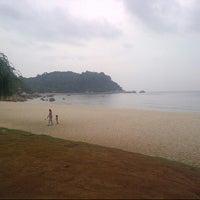 Photo taken at Pantai Teluk Cempedak (Beach) by Fendy Z. on 6/14/2013