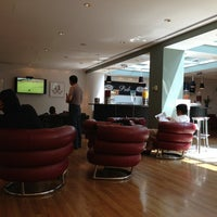 Photo taken at BA Galleries Club Lounge by Norman F. on 7/14/2013