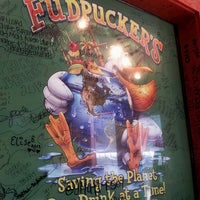 Photo taken at Fudpuckers Beachside Bar & Grill by G B. on 4/9/2013