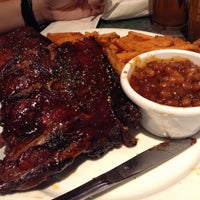 Photo taken at Smokey Bones Bar & Fire Grill by Eric C. on 4/27/2013