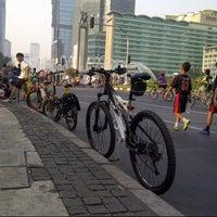 Photo taken at Jalan Jenderal Sudirman by Herry B. on 9/29/2012